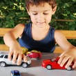 Children playing with cars toys outdoor in summer time — Stock Photo #8848847