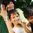 Several colors on children fingers, outdoor — Stock Photo