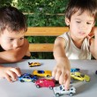 Royalty-Free Stock Photo: Children playing with cars toys outdoor in summer time