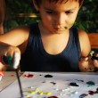 Little cute kid is playing with colors — Stock Photo