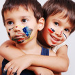 Two little cute brothers with colors on their faces — Stock Photo #8848933