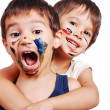Stock Photo: Two little cute brothers with colors on their faces