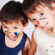 Two little cute brothers with colors on their faces — Stock Photo #8848938