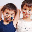 Two little cute brothers with colors on their faces — Stock Photo