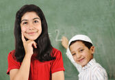 School activities on board, girl and boy in classroom — Stock Photo