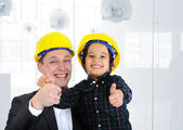 Happy boss and employee together, father and son engineers on work playing — Stockfoto