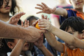 Refugee camp, poverty, hungry children receiving humanitarian food — Stockfoto