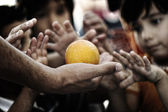 Refugee camp, poverty, hungry children receiving humanitarian food — ストック写真