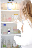 Young scientist opening refrigerator in the lab — Foto de Stock