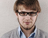 Young confident blond guy with glasses — Stock Photo