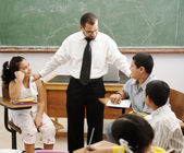 Education activities in classroom at school, happy children learning — Stockfoto