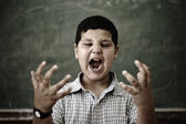 Furious mad pupil at school yelling — Stock Photo