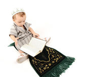 Little muslim kid is praying on traditional way — Stock Photo