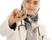 Doctor holding a pill, solution for you, closeup — Stock Photo