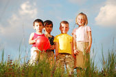 Smal group of children outdoor against sky — Stock Photo