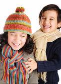 Niños lindos con ropa de invierno aislado en estudio — Foto de Stock