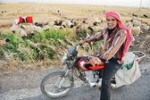 Senior shepherd on bike — Stock Photo