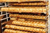 Bread on shelves — Stock Photo