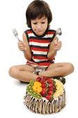 Kid preparing to eat the fruit cake — Stock Photo