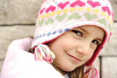 Adorable little girl with positive smiling face — Stock Photo