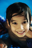 Kid in pool — Stock Photo