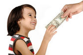 Boy receiving money from adult — Stock Photo