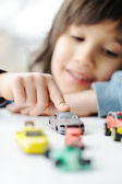 Innocence, childhood concept - playing with toy car — Stock Photo