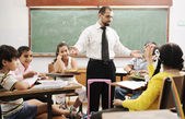 Education activities in classroom at school, happy children learning — Stock fotografie