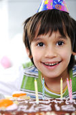 Boys with candles on cake, happy birthday party — Stock Photo
