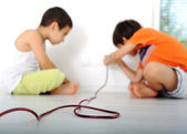 Dangerous game, children experimenting with electricity — Stock Photo
