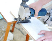 Planing a piece of wood trim for a project — Stock Photo