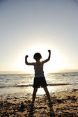 Kid on sea, silhouette — Stock Photo