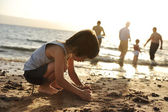 Kid on beach in sand playing, around, summer hot nice time — Stock Photo