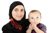 Muslim young woman with little cute baby in arms — Stock Photo