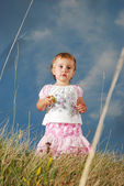 Little girl on meadow, before sunset — Stock Photo