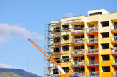 Construction site with crane and building — Stock Photo