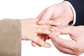 Young white male putting a ring on woman finger — Stock Photo