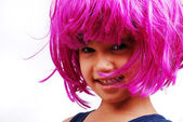 Little cute kid with pink hair and facial gesture — Stock Photo