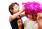 Two cute kids with pink hair and facial gesture — Stock Photo