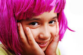 Adorable girl with pink hair and facial gesture — Stock Photo