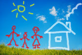 Illustrated happy family and their new home on green meadow — Stock Photo