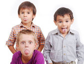Small group of children, tongue out, isolated — Stock Photo
