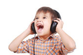 Little nice boy listening to music with peaceful expression on face — Stock Photo
