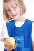 One very cute girl eating apple isolated — Stock Photo