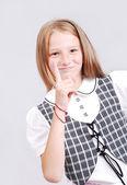 Heel schattig blond meisje wijzen door vinger geïsoleerd — Stockfoto