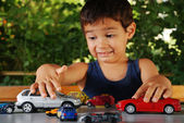 Children playing with cars toys outdoor in summer time — Stock Photo