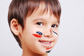 Little cute kid with colors on his face — Stock Photo