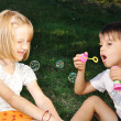 Happy cute children playing with bubbles — Stock Photo #9992186
