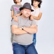 Young muslim with hat and two daughters — Stock Photo