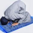 Young muslim woman praying on traditional way - Stock Photo